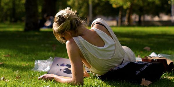 magazine reader in park