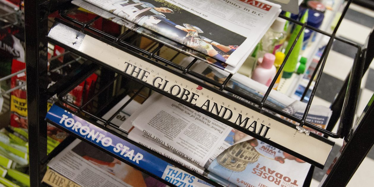 Newspapers for sale at a convenience store at Queen's University, Kingston, Ont., Feb. 8, 2016. THE CANADIAN PRESS IMAGES/Lars Hagberg